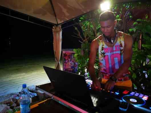 DJ, music, music by the beach, beach party, fun,