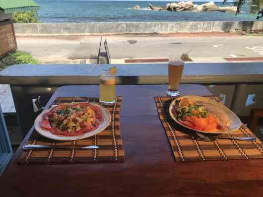 Fresh juice and smoked fish platter with sea view